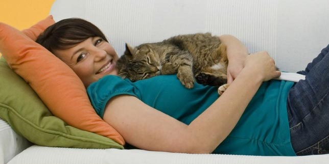 Maria snuggles with her newly adopted cat.
