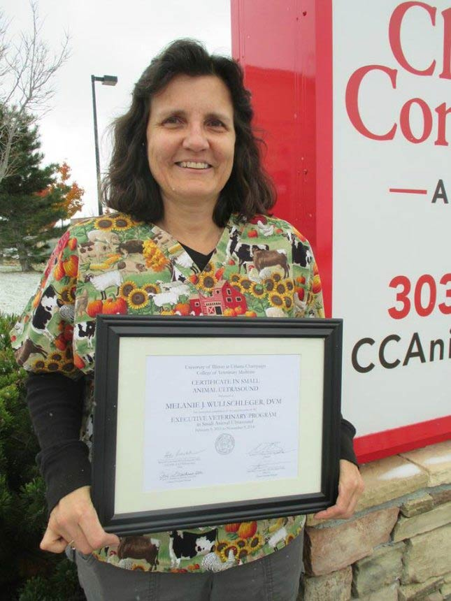 Dr. Melanie displays her veterinary ultrasound certificate.