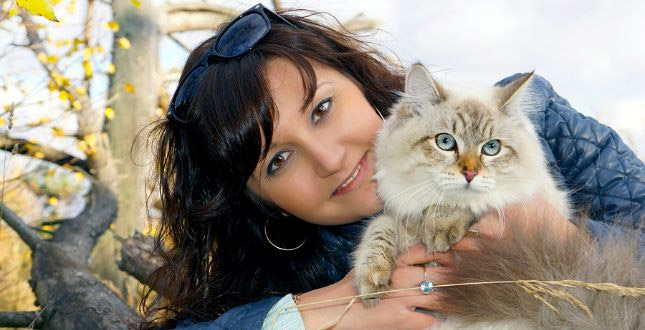 Erin holds Jade, a cat who has been on the weight loss line of the Royal Canin Veterinary Diet.