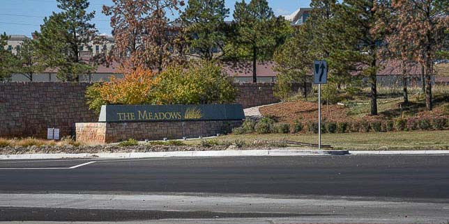 The trail parking lot is right across the road from The Meadows sign.