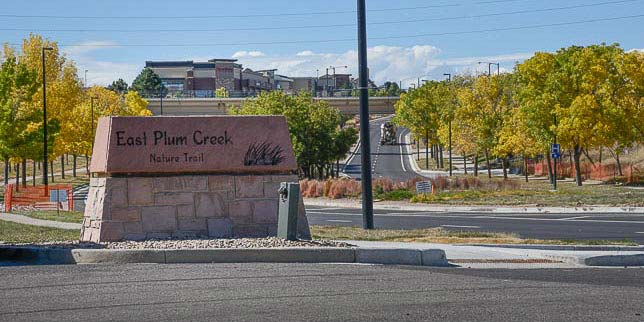 Parking lot sign for the East Plum Creek Trail in Castle Rock