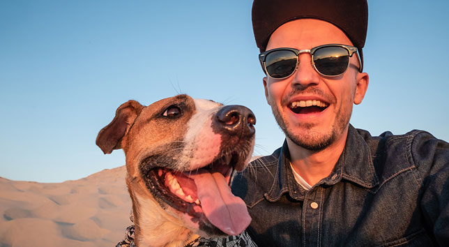 Buddy, the dog, and his pet parent, Michael, smile broadly now that Buddy doesn't have a broken tooth.